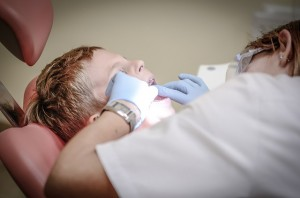 dentist checking teeth during the internship of BDS course